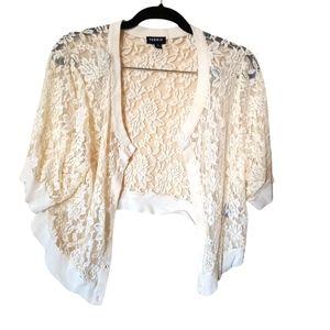TorridShort sleeve cream lace style cropped cardigan size 2